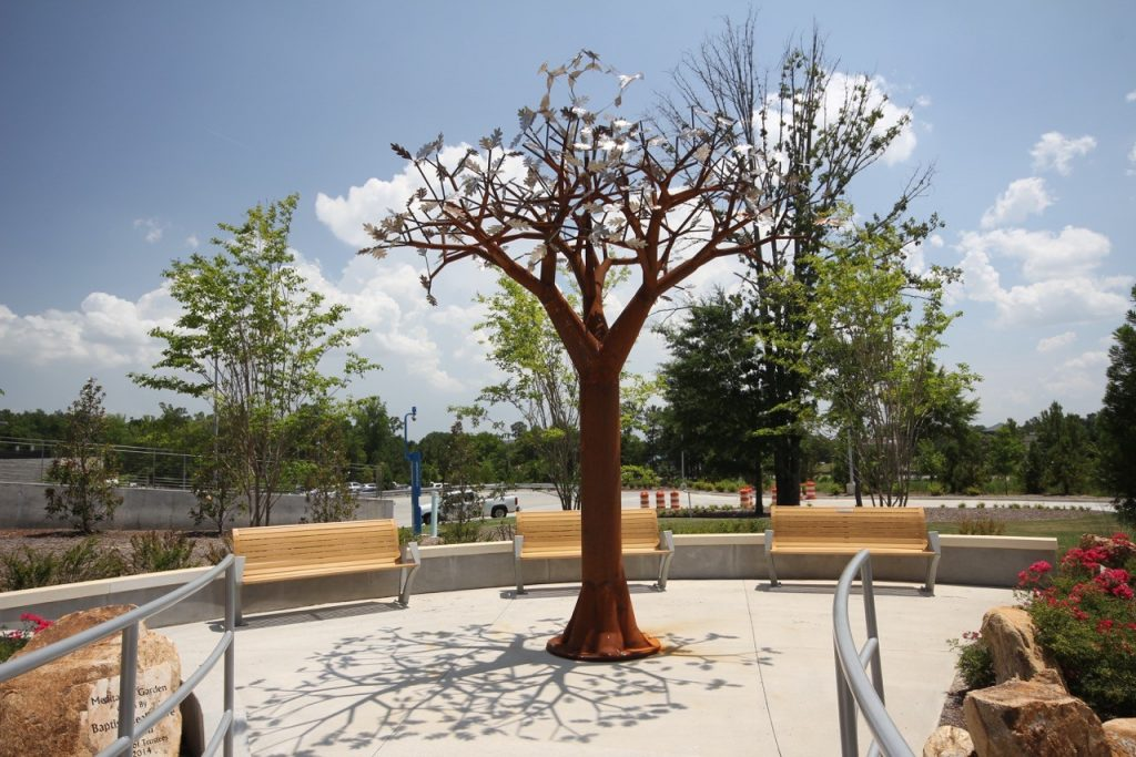 Retail center with benches and tree structure